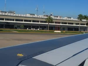 view from wing of airplane to airport